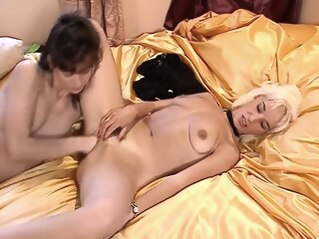 blonde brunette fisting at FapVid